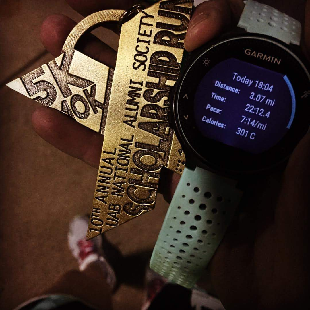 A Garmin Forerunner 235 showing a 1st place finish for a 5k runner.