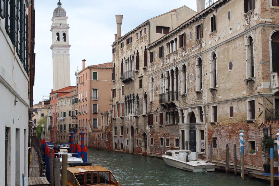 Many beautiful canals can be seen during a walk around Venice, Italy.