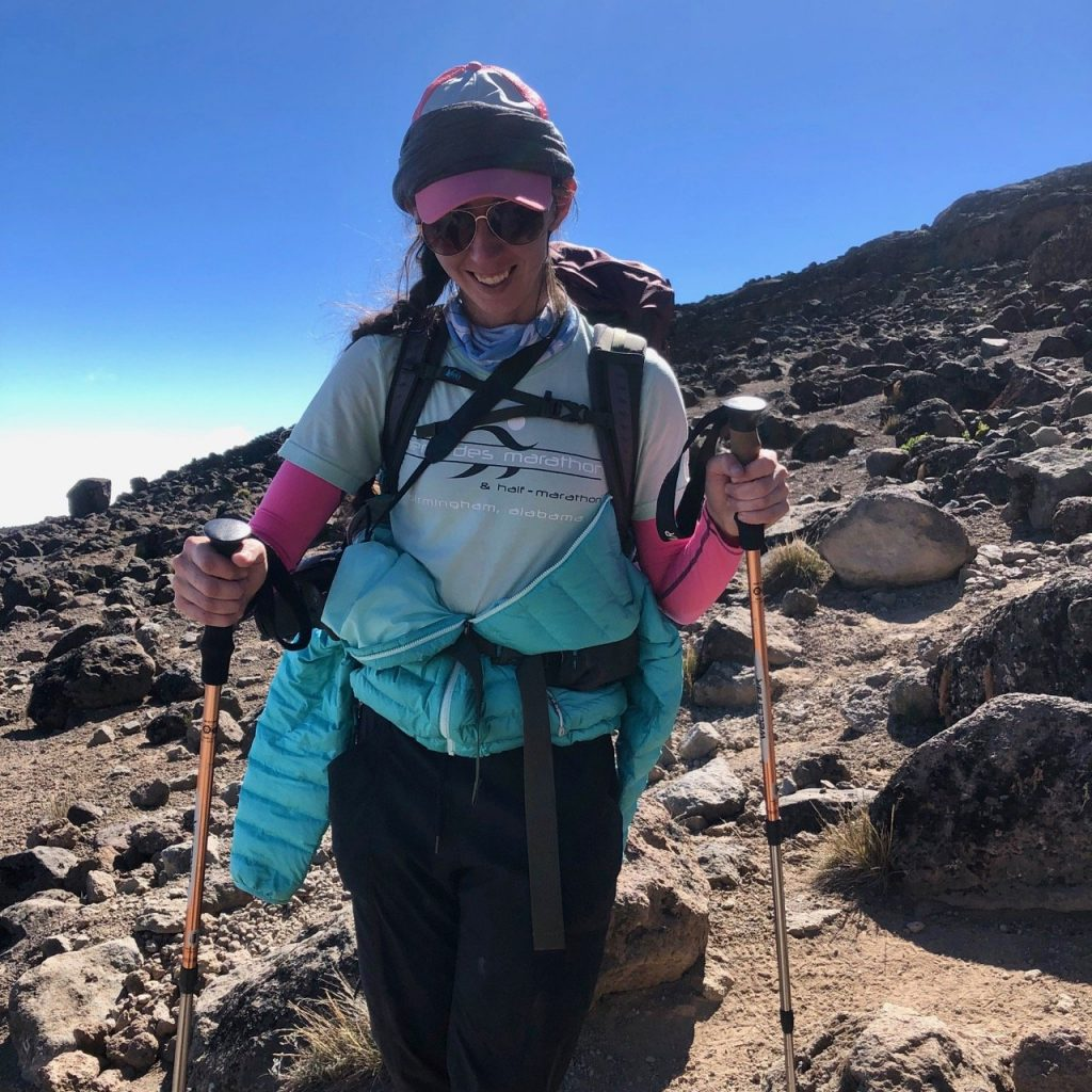 Hiker shows her ability to layer clothes that she packed from her Kilimanjaro packing list.