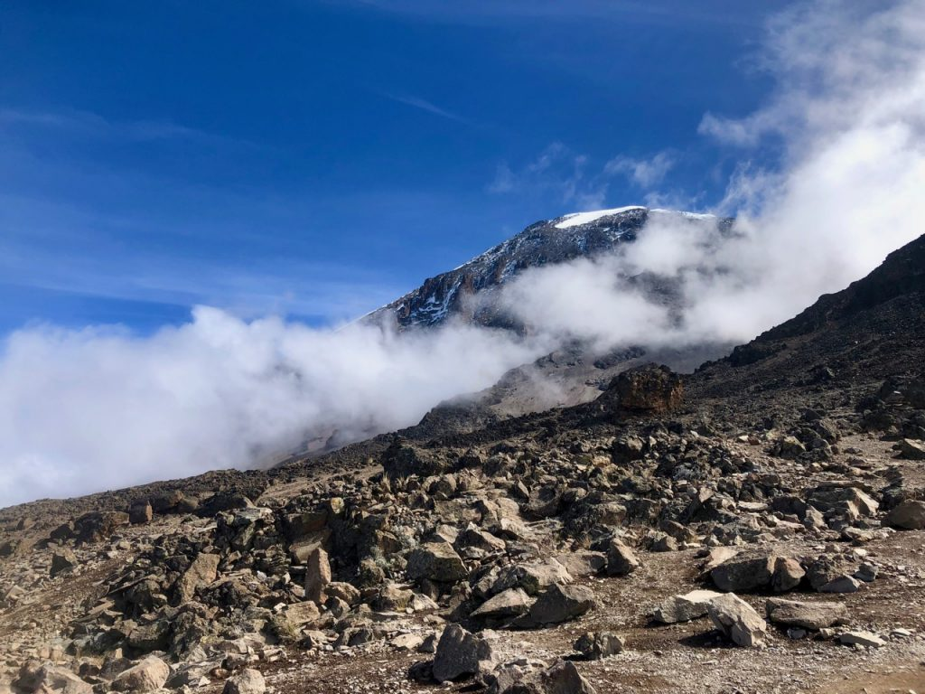 A look at the peak of Kilimanjaro through a few clouds from the Machame route.