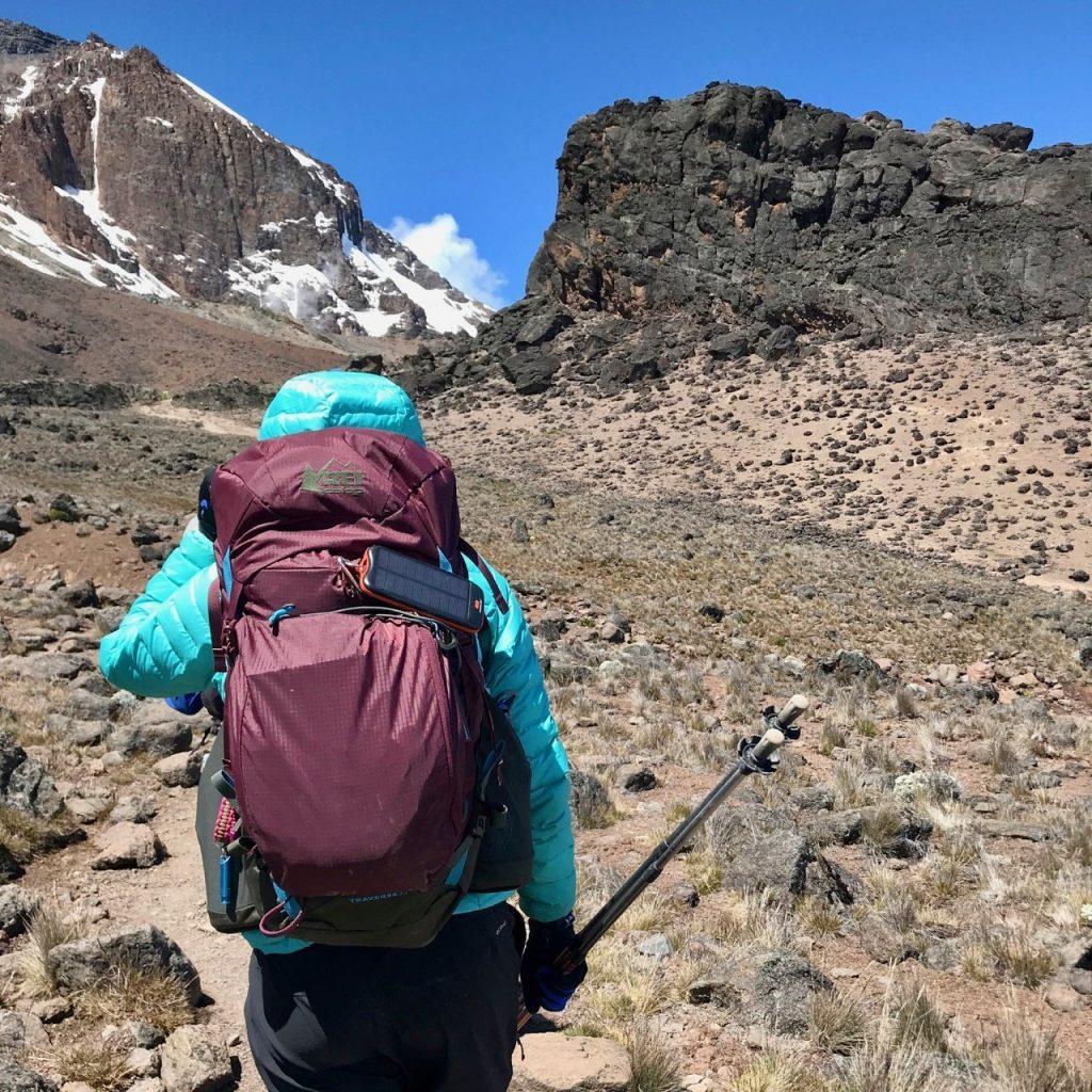 Hiking towards Lava Tower with a fully stocked backpack full of the gear from her Kilimanjaro packing list.